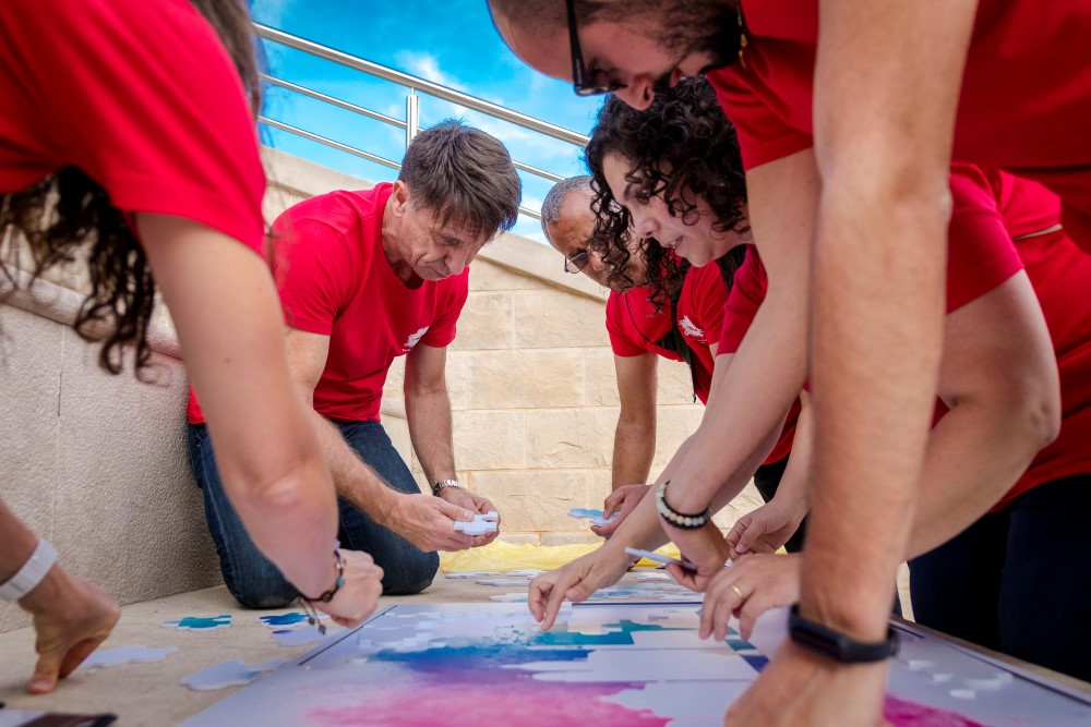 Teams solve a Giant Puzzle as one of the steps to complete the Challenge