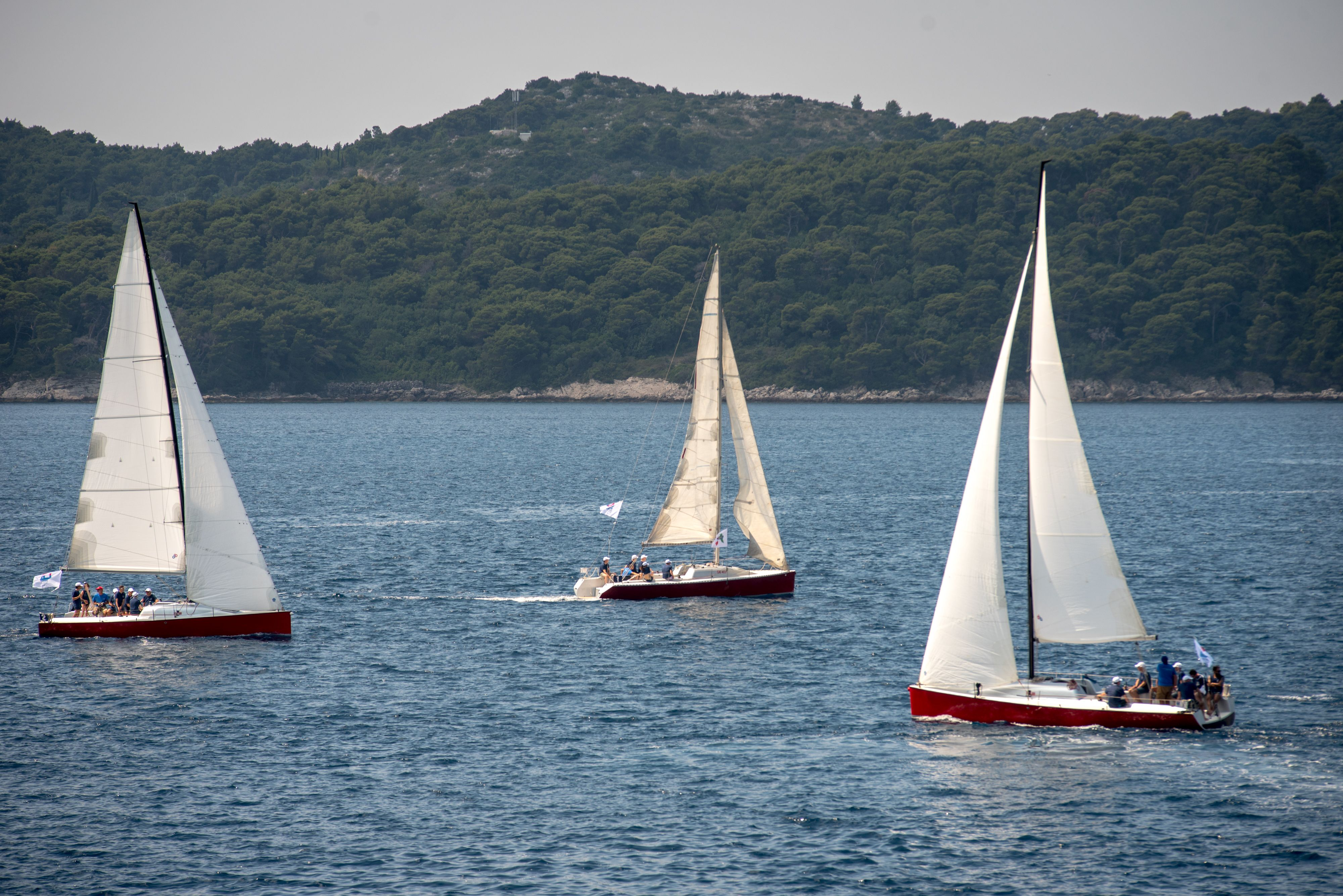 three sail boats at regatta