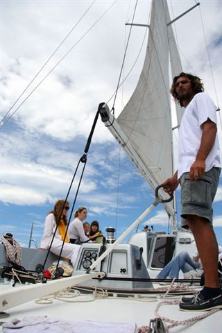 Team helps captain in a sailboat race